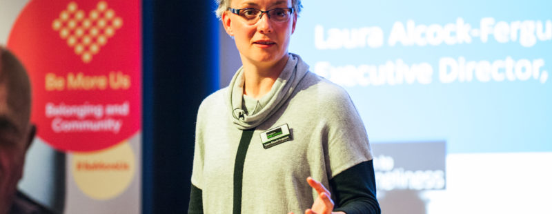 Laura speaking at conference