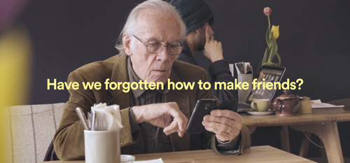 An older man using a phone - text reads: Have we forgotten how to make friends?'
