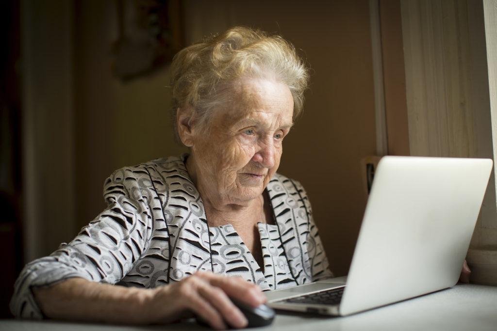 An older woman using a computer