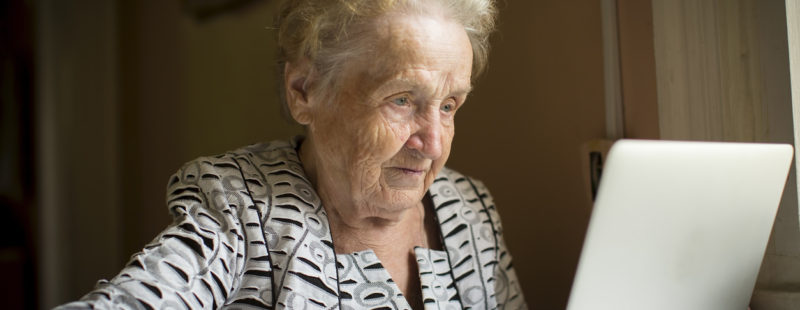 An older woman using a computer
